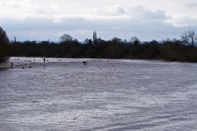 The Severn Bore approaching around the bend in the river