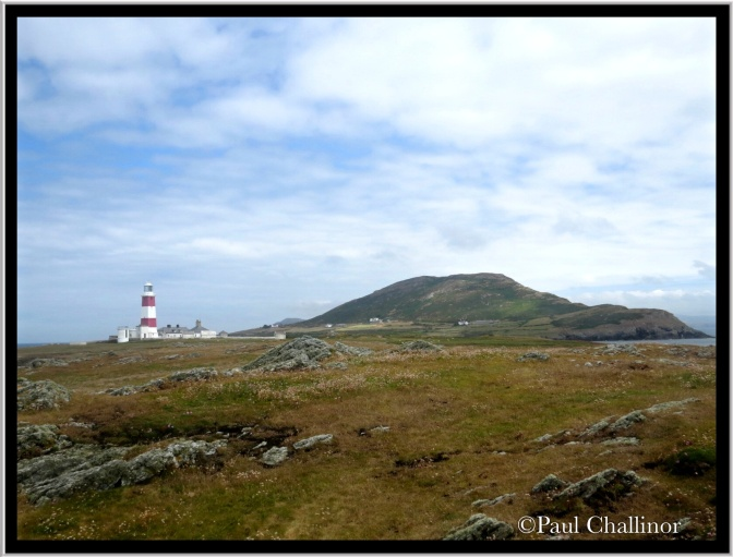 The light house with Mynydd Enlli in the background.