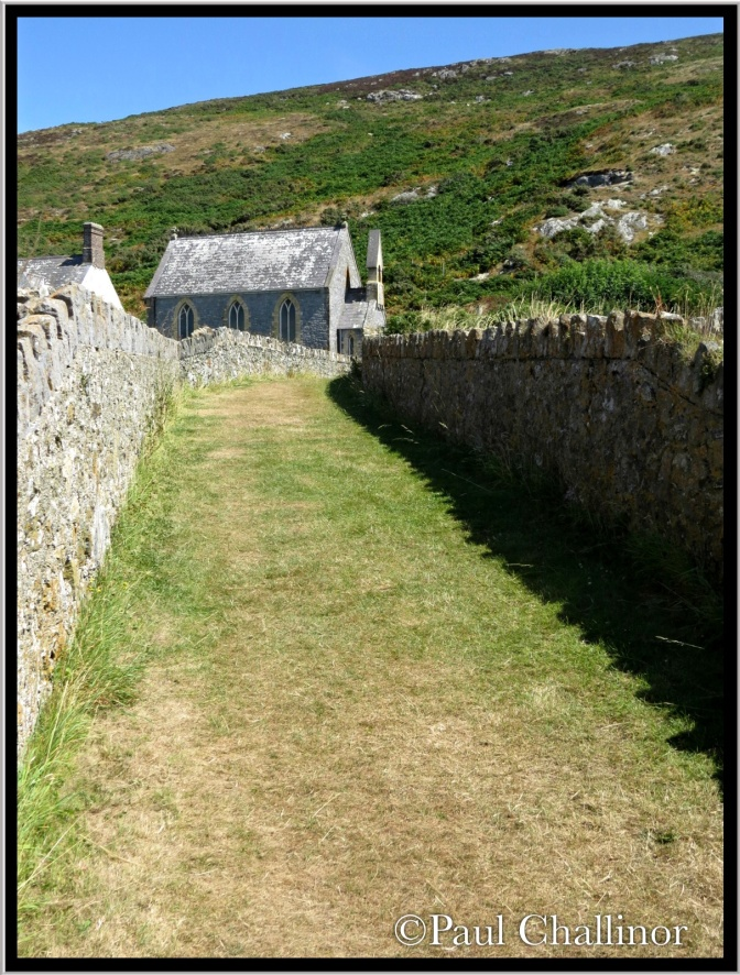 The path to the chapel. There is no resident preacher any more, but the sign outside the gate suggests that preacher visit for a week or more to provide services to those who travel to the island.