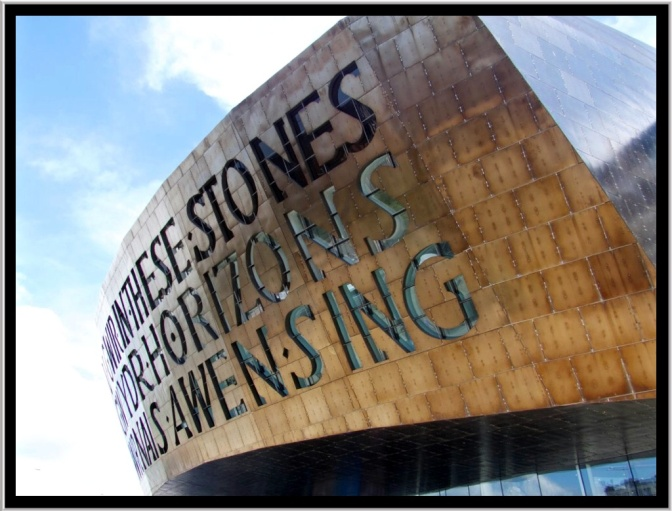 "Inscribed on the front of the dome, above the main entrance, are two poetic lines, written by Welsh poet Gwyneth Lewis. The Welsh version is Creu Gwir fel gwydr o ffwrnais awen, which means ""Creating truth like glass from the furnace of inspiration."" The English is In These Stones Horizons Sing."