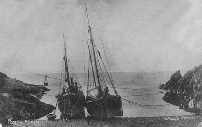 A old photo of Poth Ferin showing boats pulled up onto the beach.
