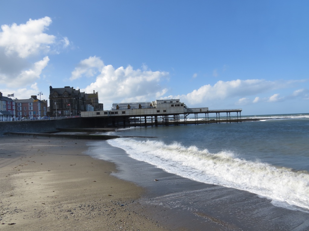 Looking south towards pier. The original University can be seen behind. This gothic style building was originally built as a hotel when the railway arrived in Aberystwyth.