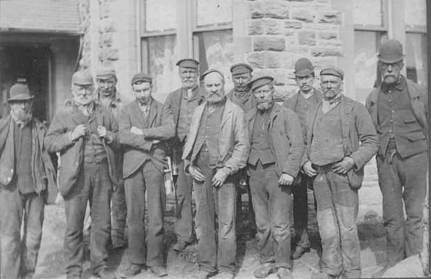 A group of 19th C coal miners from the surrounding valley. A tough looking lot doing a tough and dangerous job.