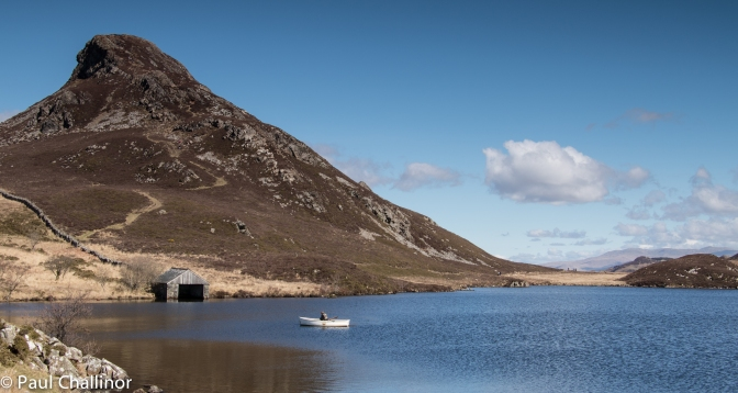The boat house with Bryn Brith standing proud behind.