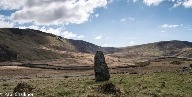 One of the the larger standing stones near the lake with the ridge of Craig-y-Llyn behind, there are a number of cairns along this ridge