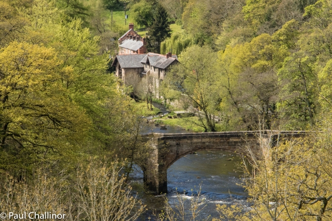 Looking down towards the River Dee. The building on the other side of the bridge is an old water mill.