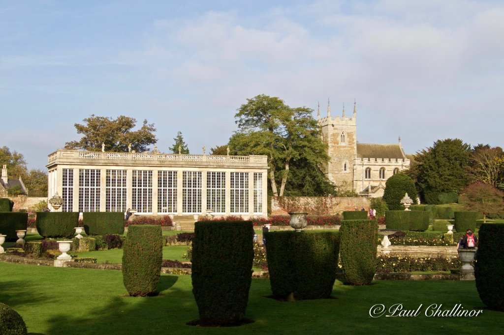 The Italianate Garden with the Orangery and church in the background.