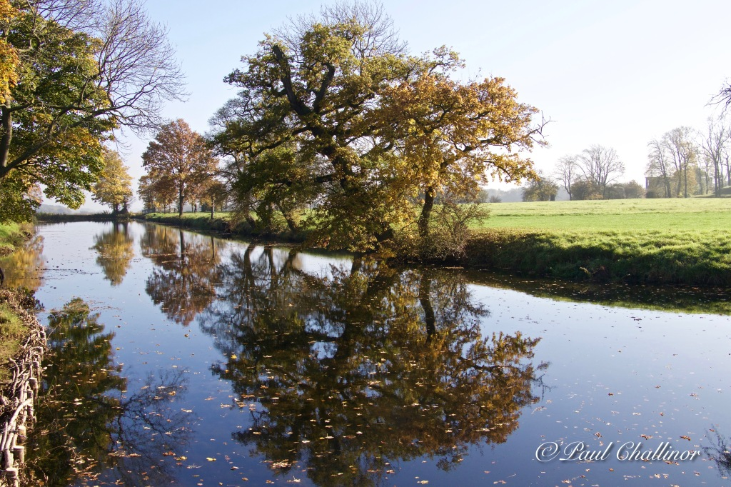 Autumn colours reflected in the moat.