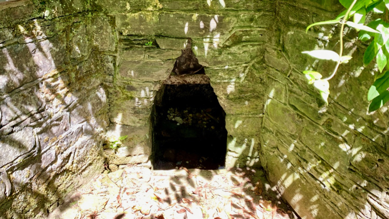 The well alcove, although empty of water still held votive offerings.